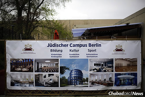 A poster with the planned new Jewish campus is displayed at the Chabad Educational Centre in Berlin. (AP Photo/Markus Schreiber)