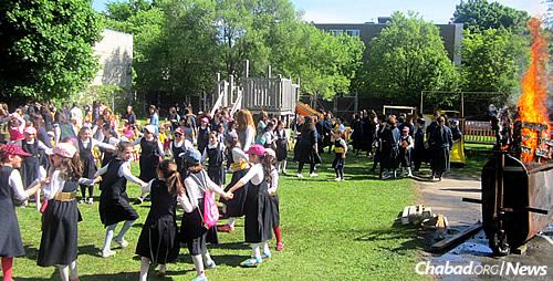 """At Beth Rivkah, girls enjoy a large bonfire before the parade, and they """"dance in Montreal like they do in Meron,"""" says Rabbi Minkowitz."""