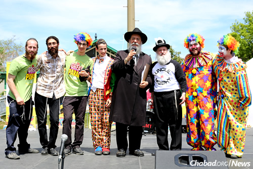 Rabbi David Cohen, center, has organized the Montreal parade for nearly 20 years. He's shown here at last year's event with some of the entertainers.
