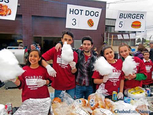 CTeen volunteers helped serve food, including hot dogs, burgers and cotton candy.
