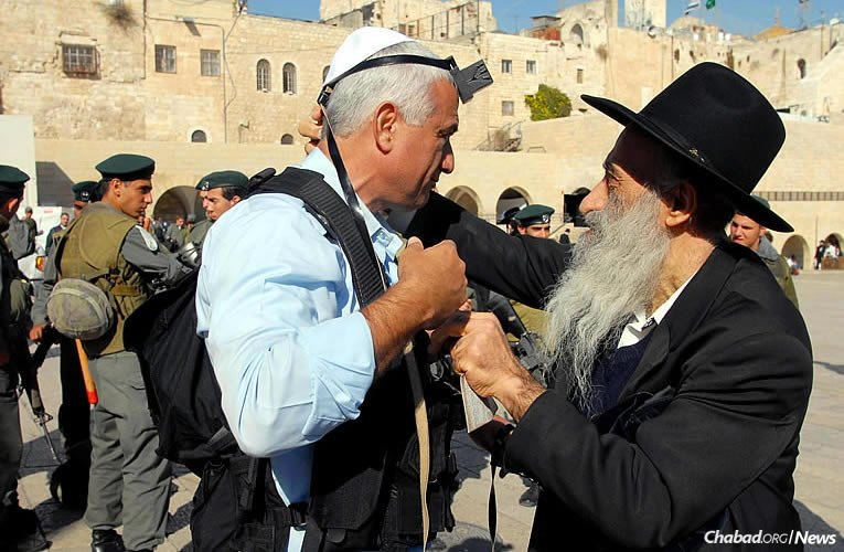 The Chabad-Lubavitch tefillin stand at the Western Wall in Jerusalem opened on June 15, 1967. Millions of Jews have since put on tefillin there, transforming emotions felt at one of Judaism's holiest sites into action. (Photo: Mark Neyman/Israel Government Press Office)