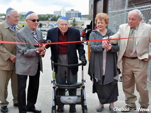 Cutting the ribbon, from left: Rick Balbi, Murray Robins, Sam Switzer, Leslie Levant and Dr. Marvin Levant. Assisting them were Saundra Shapiro and Loren Molever (not pictured).