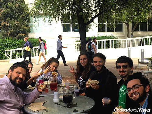 """The eatery serves as a venue for lunch-and-learn programs offered by Rabbi Tiechtel, left. Third from left is freshman Neta Galili, who says """"the rich flavors remind me of Israel."""""""