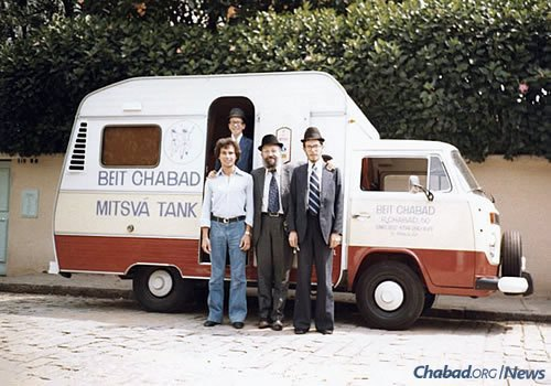 Chabad-Lubavitch emissaries pose by a newly purchased tank in São Paolo, Brazil. (Photo: Library of Agudas Chasidei Chabad)