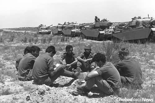 For weeks before the war, Israel slowly mobilized its reserves, with husbands, fathers and sons leaving their lives and reporting to active duty. While Israel attempted to negotiate a diplomatic solution to the crisis, they waited. Here, a tank unit awaits orders on the southern front. (Photo: Moshe Milner/Israel Government Press Office)