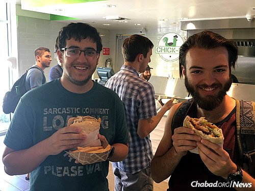 Eliyahu Gibly, left, and Hal Danesh take a break to enjoy a typical Israeli-style lunch.