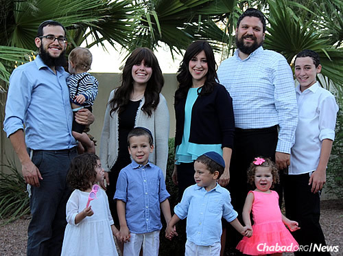 The Tiechtels and the Rimlers, Chabad-Lubavitch emissaries who serve students at Arizona State. Top, from left: Rabbi Mendy Rimler holding Eli Rimler, Sarah Rimler, Chana Tiechtel, Rabbi Shmuel Tiechtel, Tzvi Tiechtel. Bottom, from left: Chayala Rimler, Meir Tiechtel, Levi Tiechtel, Mina Tiechtel.