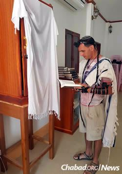 Praying in the ad-hoc synagogue, which faces west towards Jerusalem.