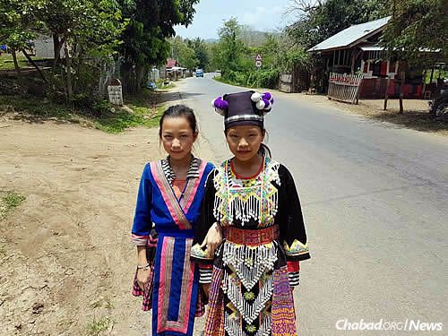 Many in Laos still cling to their customary dress.
