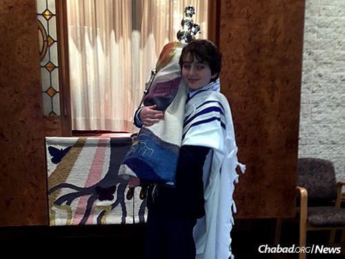 Noah holds the Torah at a lesson for his bar mitzvah ceremony in Cleveland.