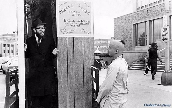 Rabbi Nosson Gurary, Chabad emissary in Buffalo, N.Y., speaks with a Jewish student on campus at SUNY Buffalo in the early 1970s. (Photo: Kehot Publication Society)