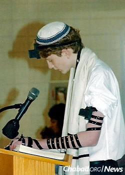 Aidan wears his own tefillin at eighth-grade graduation from his Jewish day school in Cleveland.