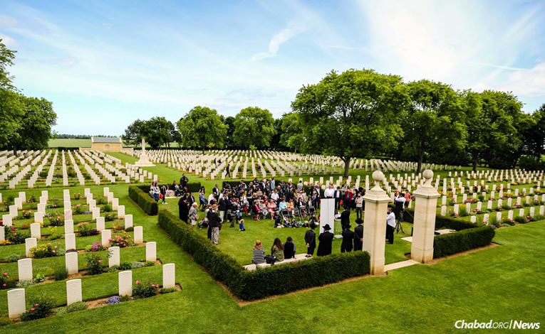 Families gather to mark the 73rd anniversary of the Normandy invasion by Western allies in World War II and dedicate a new Torah scroll for Jewish soldiers who lost their lives in the course of brutal fighting there. (Photo: David Karsenty)