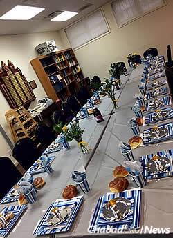 A table set up and ready for Shabbat dinner