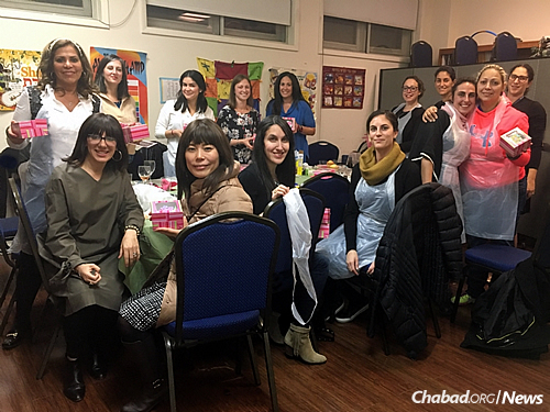 Women gather for a program at the Chabad center