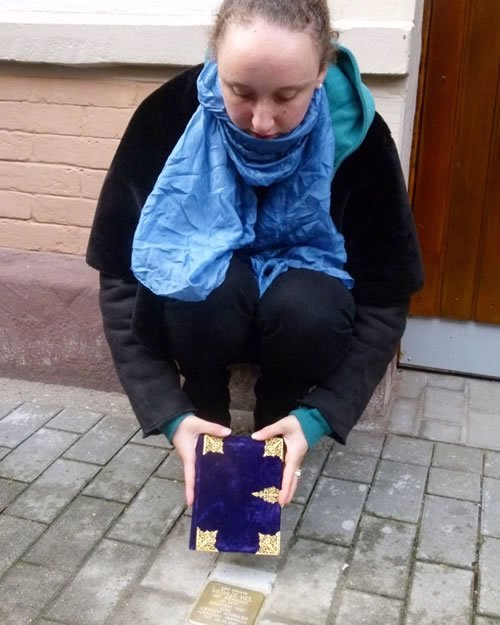 Me with Mathilde's siddur, at her stone.