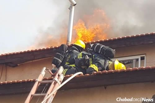 Firefighters check that no one is trapped inside a burning building.