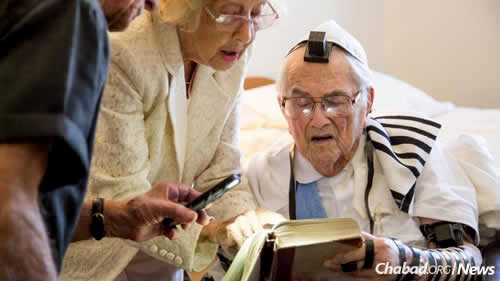 Reciting prayers in tallit and tefillin. (Photo: Tracy Glantz/The State)
