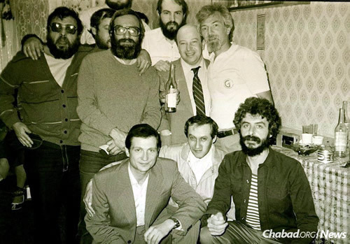 A Moscow farewell party in 1987 for Yuli Edelstein, bottom left, who after having served three years in Soviet gulags was immigrating to Israel with his family. (Photo courtesy of Association Remember and Save)