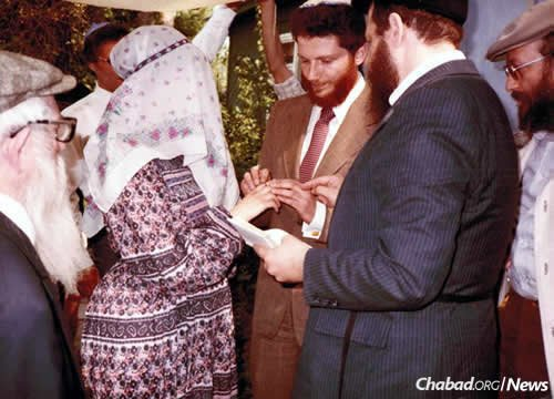 Edelstein's chuppah with his late wife, Tanya, in 1983. Performing the ceremony is the late scholar and author Rabbi J. Immanuel Schochet, who traveled to the USSR that year on Chabad's behalf. Rabbi Getche Vilensky of Moscow, far left, looks on. (Photo courtesy of Rabbi Yitzchak Schochet)