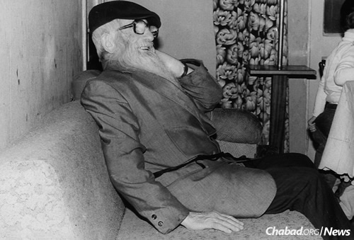 Vilensky was an old-time Lubavitcher Chassid who inspired circles of young Jewish refuseniks in Moscow. Many of his students later became teachers in their own right. Here, he watches the scene on a couch at the Kara-Ivanov's apartment during their son's upshernin in the early 1980s. (Photo courtesy of Michael Kara-Ivanov)