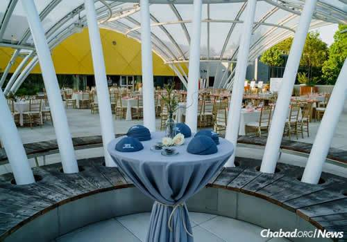 The tables were elegantly set outdoors, despite the impending inclement weather. (Photo: Avraham Edery)