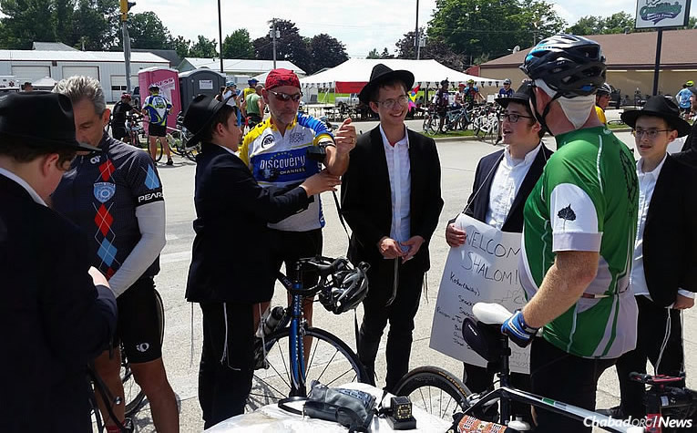 "Rabbis, yeshivah students and campers greeted participants in the ""Register's Annual Great Bicycle Ride Across Iowa,"" offering kosher food, conversation and the chance for Jewish men to wrap tefillin as they pedaled through Postville. (Photo: Chabad of North East Iowa)"