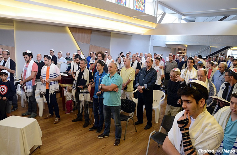 Inside a new building and synagogue, Jewish men and boys over the age of 13 gathered for prayer, words of Torah, to meet friends and to savor refreshments as part of an event that marked 50 years of the Rebbe's Tefillin Campaign. (Photo: Beit Chabad de Belo Horizonte)