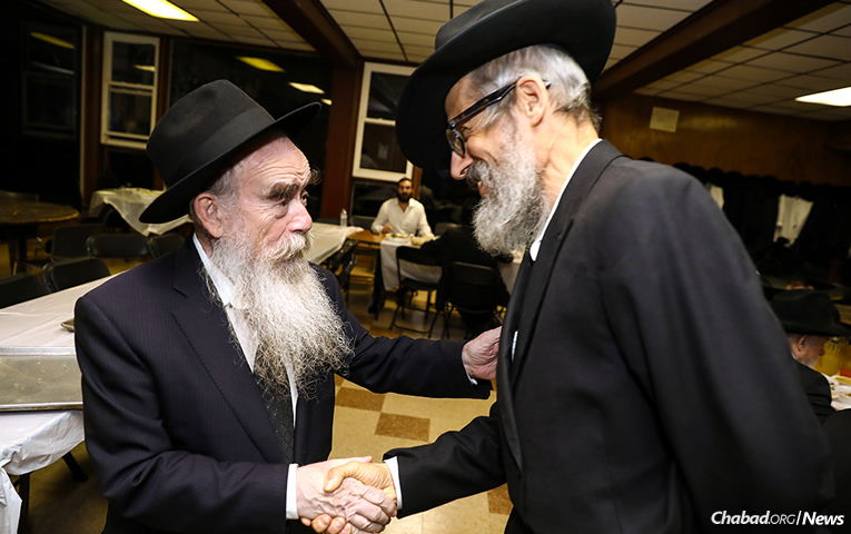 Rabbi Abraham Shemtov, left, chairman of Agudas Chasidei Chabad and director of Camp Gan Israel, greets Rabbi Leibel Shuchat, dean of Yeshiva Guedola de Venezuela rabbinical seminary in Caracas, to the Yarchei Kallah summit in Parkesville, N.Y. (Photo: Shimi Kutner)