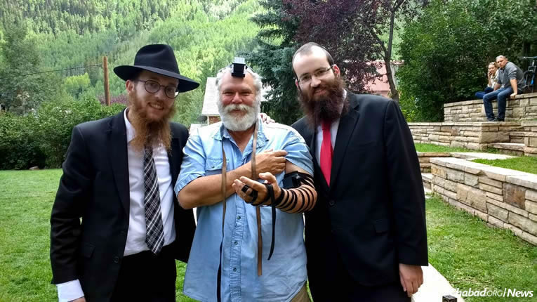 Rabbinical students Mendel Teifenbrun, left, and Mendel Liberow, right, celebrated the Jewish milestone of Christopher (Bienbrech) Bonebrake this week in Telluride, Colo.