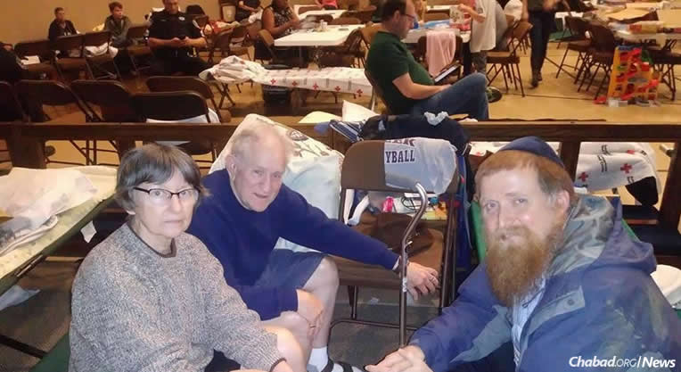 Rabbi Yitzchok Schmukler with evacuees at a Houston shelter. He is chronicling his experiences during the ongoing devastation in Texas.