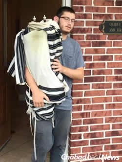Evacuating Torah scrolls from Chabad of Sugar Land.