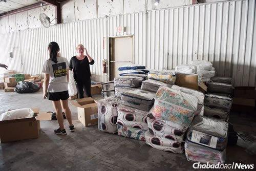 The aid trucks include kosher food such as meat, poultry and milk, but also masks and tape for cleanup efforts. Here, packages of new bed linens are stacked up at Chabad Harvey Relief for distribution to flood victims in the city. (Photo: Elisheva Golani/Chabad Harvey Relief)