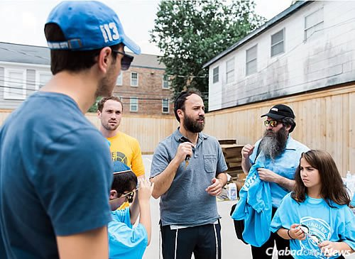 Rabbi Zev Johnson, center, co-director of the Rohr Chabad Jewish Student Center at the University of Texas in Austin, led a group of more than 50 Jewish Longhorns to provide support for area residents. (Photo: Elisheva Golani)