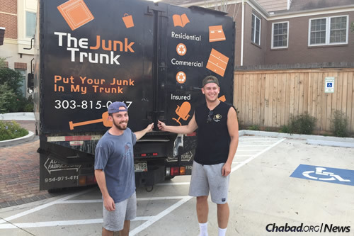 Geoff Mitler, left, with college senior Ben Davis, who works for The Junk Trunk owned by his friend and CU graduate Nathan Schweid. When Davis asked if Chabad at CU could use the company truck to transport supplies, Schweid didn't hesitate for a moment.