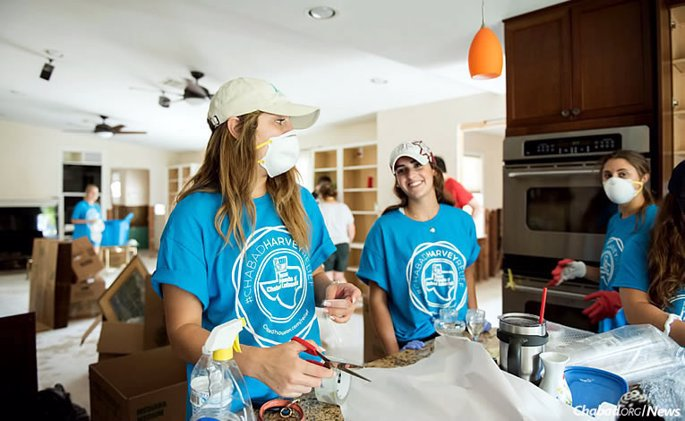 Student volunteers from college campuses as far away as Boulder, Colo., arrived en masse in Texas on Sunday to spend their Labor Day weekend pitching in, like these women cleaning up the kitchen in a family home in Houston. (Photo: Elisheva Golani)