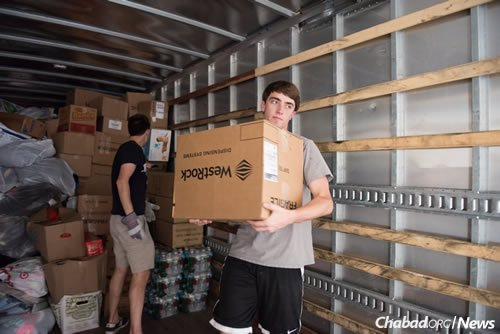 Volunteers have been unpacking trucks arriving at the Chabad Harvey Relief operations center since Thursday, with more trucks expected this week. (Photo: Elisheva Golani/Chabad Harvey Relief)