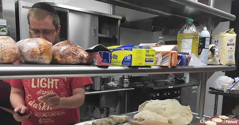 A volunteer at Aishel House at the Texas Medical Center in Houston prepares kosher food for flood victims. With stores that typically carry kosher-food items under water, staples and supplies are not available.