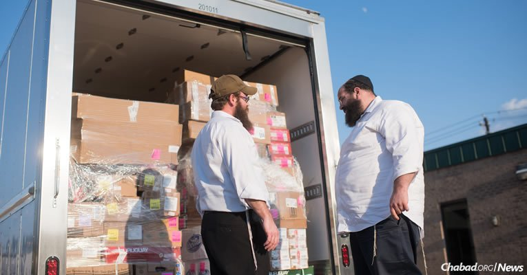 Rabbi Dov Mandel, right, director of Chabad of Fort Worth, Texas, stands with Rabbi Mendy Traxler of Chabad of Houston. A truck carrying kosher food from Miami was unable to make it to Houston due to flooding and closures, and was re-routed to Dallas. Mandel transferred the goods into a truck he rented and drove to Houston himself. (Photo: Elisheva Golani/Chabad Harvey Relief)