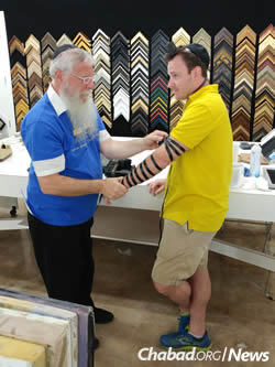 Rabbi Avrohom Litvin of Louisville, Ky., helped victims and volunteers put on tefillin.