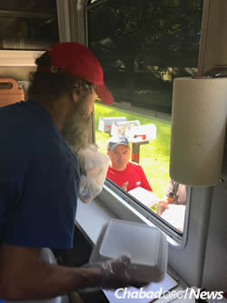 Rabbis joined Red Cross volunteers to deliver food to flood victims.
