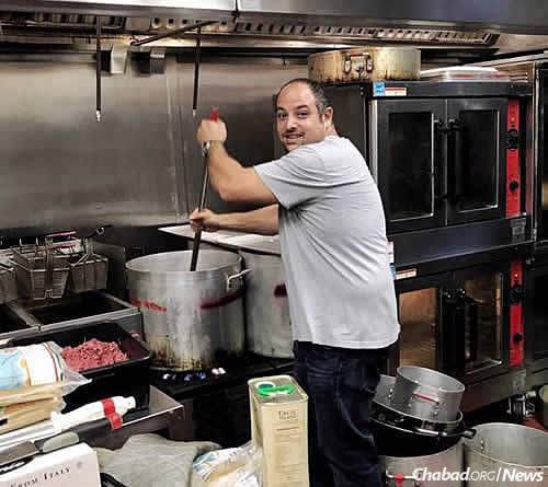 Employees of Aroma Market & Catering company in Cooper City, Fla., near the state's southeastern coast, have been using its commercial kitchen to prepare large amounts of kosher food, cooking hundreds of meals to send to Chabad of Naples on Florida's southwestern coast.