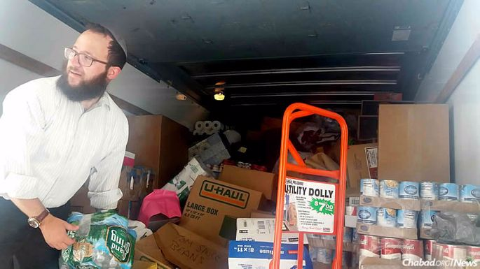 """Chabad Rabbi Mendy Hecht of New Haven, Conn., along with former rabbinical-school classmates and a number of Jewish community members, led a """"Convoy of Hope"""" that brought truckloads of desperately needed supplies to storm-ravaged Houston."""