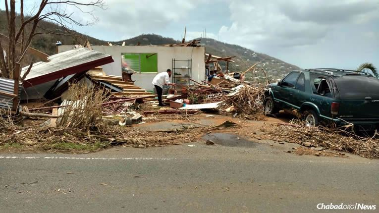 Rabbi Asher Federman, co-director of Chabad-Lubavitch of the Virgin Islands, has remained on St. Thomas, which was devastated by Hurricane Irma, to give what material and spiritual comfort he can to the island's small Jewish community.