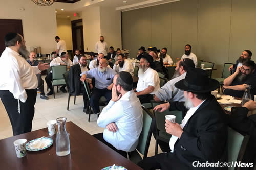 The rabbis are briefed before setting out on their missions.