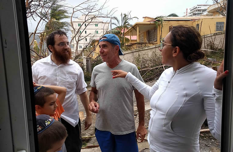SIGHS OF (SOME) RELIEF: Rabbi Moishe Chanowitz, co-director of Chabad of St. Martin/St. Maarten, checks in with Jewish community members on the devastated Caribbean island. In the days since Hurricane Irma hit, he and his wife, Sara, have been reaching out to friends, neighbors and community members to account for everyoneK.
