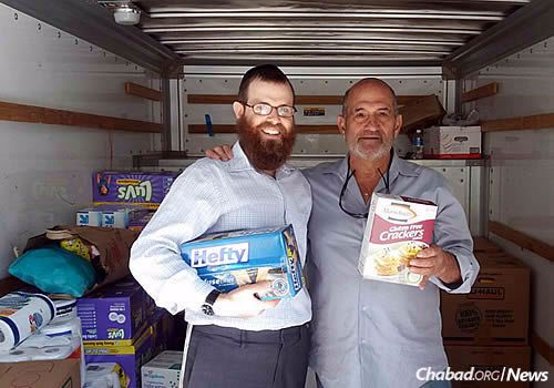 The supplies were gratefully received, especially nonperishable kosher food. Here, a community member stands with Rabbi Levi Schectman, left, of Chabad at Wesleyan University in Middletown, Conn.