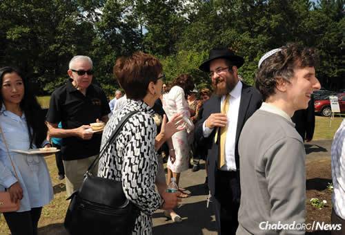 Speaking with guests at the reception following the ceremony.