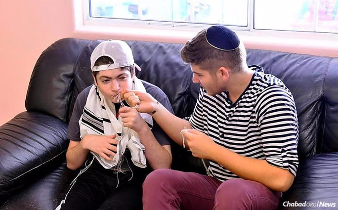 A Jewish teen, left, spends time with his Friendship Circle volunteer. The Chabad-Lubavitch-affiliated organization has been awarded a $250,000 grant by The Jewish Community Foundation of Los Angeles for its work supporting children and adults with special needs. (Photo: Friendship Circle of Los Angeles)