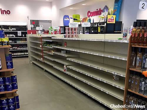 Store shelves are wiped clean as food becomes harder to find.